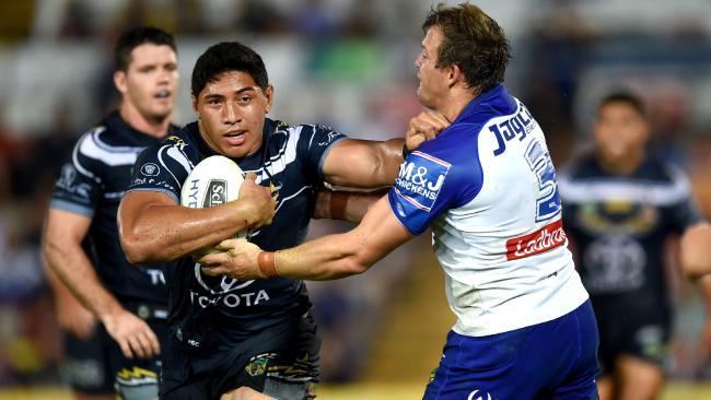 Jason TAUMALOLO fights off Josh MORRIS . NRL. North Queensland Cowboys Vs Canterbury-Bankstown Bulldogs at 1300smiles Stadium. Picture: Alix Sweeney