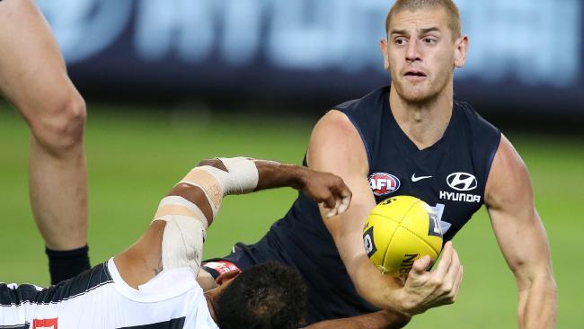 Carlton's Liam Jones battles with Collingwood's Travis Varcoe. Pic: Michael Klein