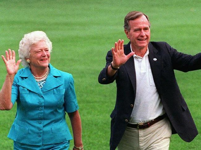Barbara, George Bush and pet dog Millie on the south lawn of the White House, August 1992.