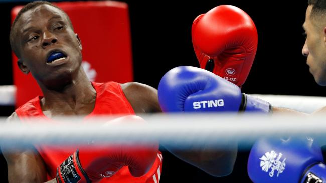 Cameroon's Simplice Fotsala competes in the boxing at the Gold Coast Commonwealth Games. He's one of eight athletes from Cameroon who disappeared from the athlete's village. Picture: AFP/Adrian Dennis