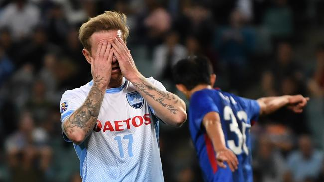 Sydney FC's David Carney reacts after missing a scoring chance against Shanghai Shenhua. Picture: David Moir/AAP