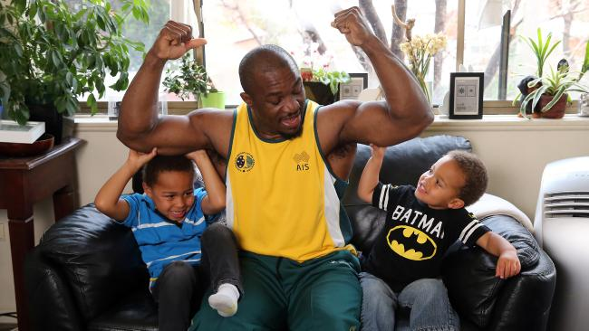 Simplice Ribouem, with sons Nathan and Samuel. He fled the Cameroon team at the Melbourne Commonwealth Games in 2006, received refugee status and now competes for Australia. Picture: Alex Coppel
