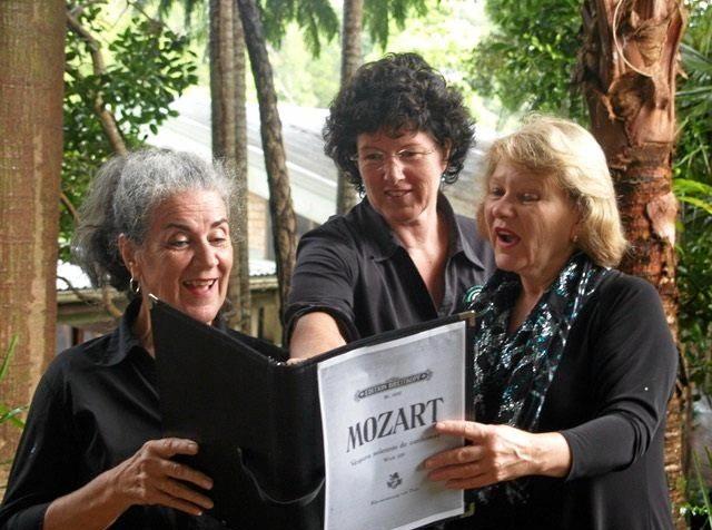 SING FOR YOUR SUPPER: Sunshine Coast Oriana Choir members Barbara White, Joe Evans and Evalee Sharples pracitising their Mozart.