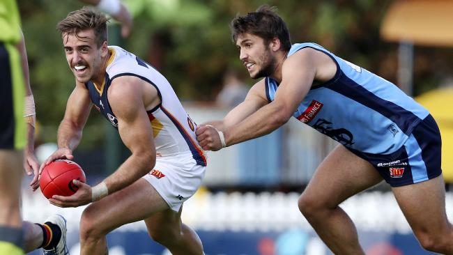 Jordan Gallucci, in action for the Crows SANFL side against Sturt, is in the frame to come into the Adelaide side to take on Sydney. Picture: SARAH REED