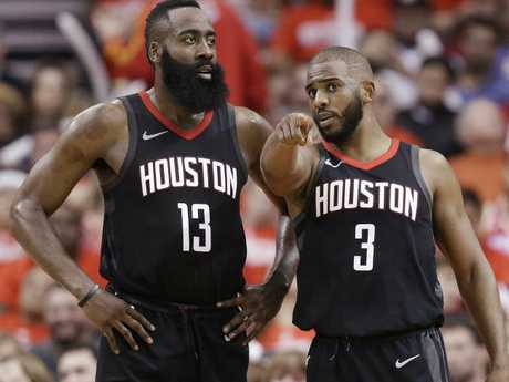 Houston Rockets guard Chris Paul talks to guard James Harden.