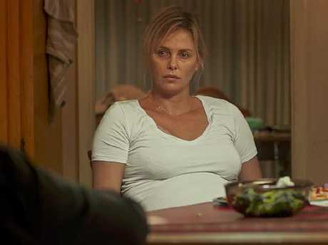 Theron says she gorged on mac and cheese at midnight to gain weight for the role.
