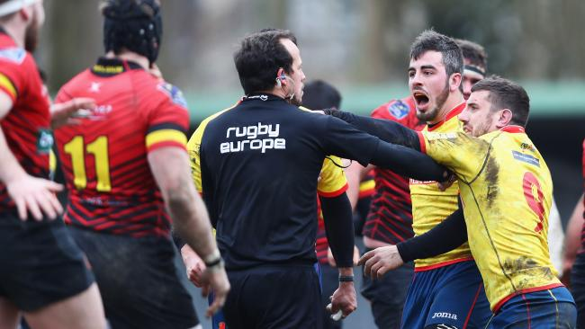 Spanish players confront the referee after losing their Rugby World Cup 2019 Europe Qualifier match against Belgium. Picture: Getty Images