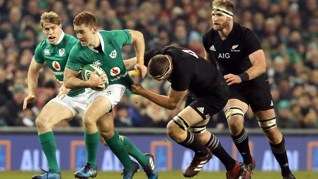 Ireland's Paddy Jackson (L) in action against the All Blacks.