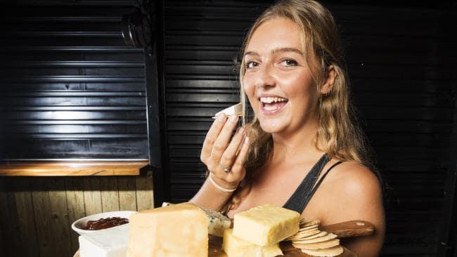 Jess Benneworth, 24, tucks into a cheese platter in Noosaville.