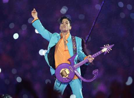 FILE - In this Feb. 4, 2007 file photo, Prince performs during the halftime show at the Super Bowl XLI football game at Dolphin Stadium in Miami.