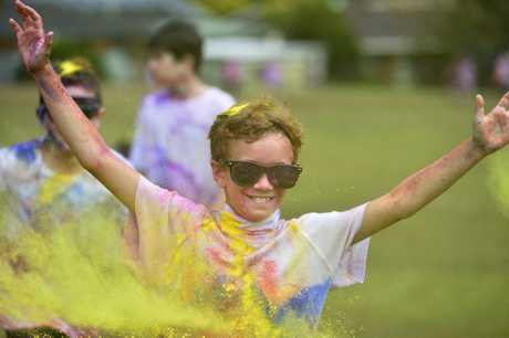 Charlie Waters in the colour fun run at Rangeville State School, Friday, April 20, 2018.