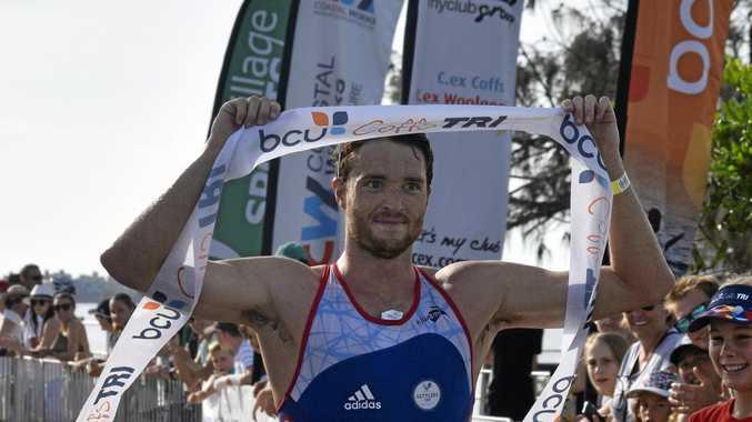 Harry Jones crosses the line to win the Coffs Harbour Triathlon last month.