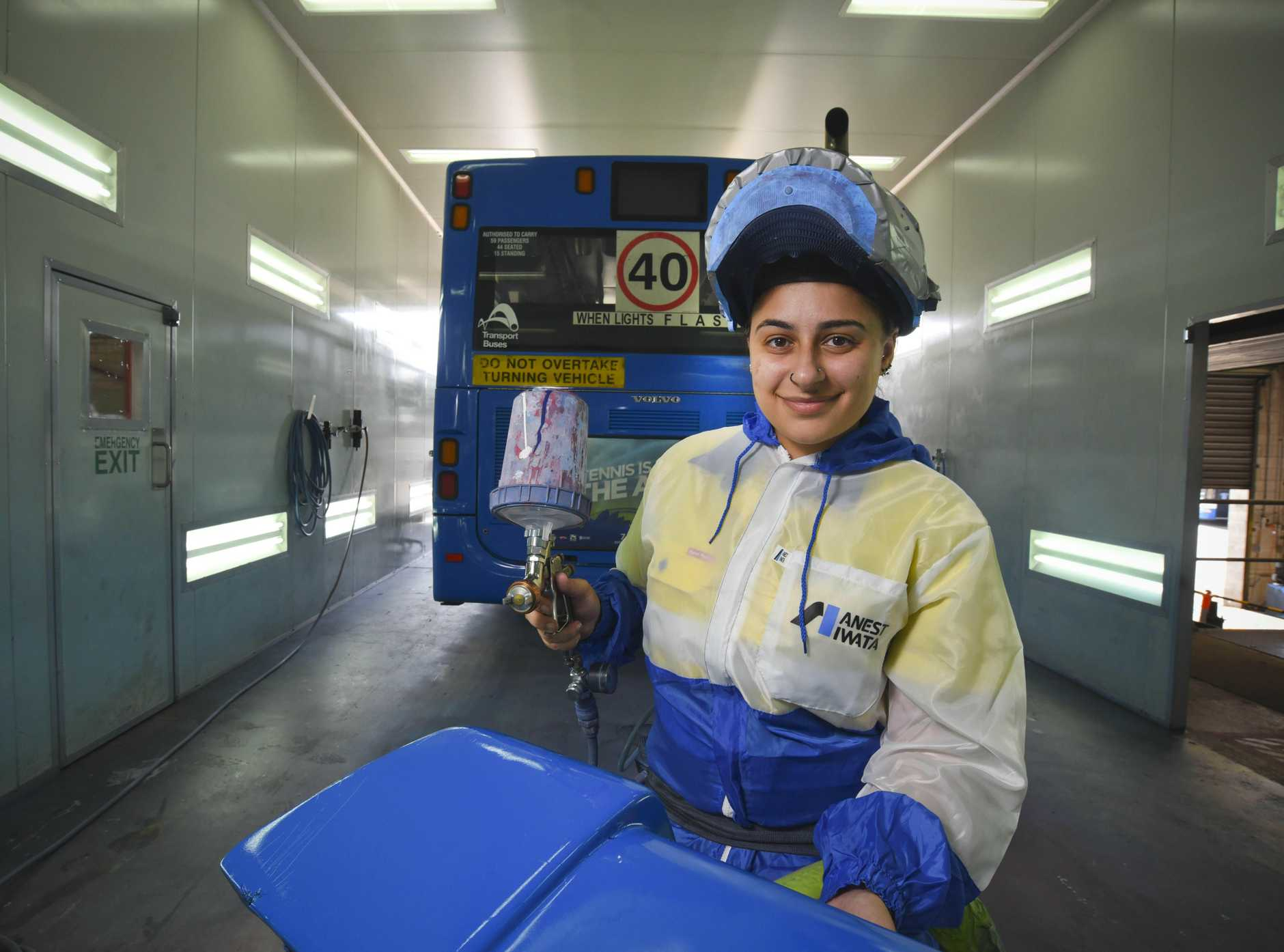 MOTORING ON: Apprentice bus painter Dimitria Klokas enjoys the challenge of difficult repairs.