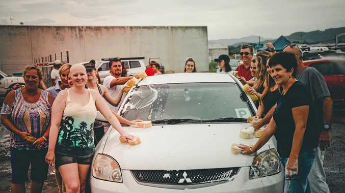 FUNDRAISE: Caitlin Ambrose and friends at the car wash in Murwillumbah.