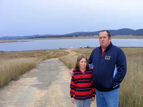 Andrew Gale and daughter Amy in 2010 in the same spot at Leslie Dam, at the start of an eight year long fight to have boat ramps extended.