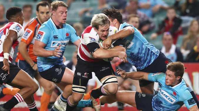 Marnus Schoeman smashes through the Waratahs defence to score. Picture: Matt King/Getty