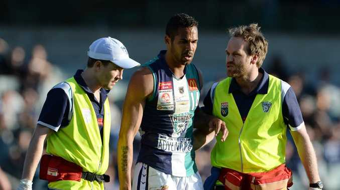 SPORT - WAFL Grand Final, Subiaco Lions vs Peel Thunder, Subiaco Oval, Perth. Photo by Daniel Wilkins. PICTURED- Peel's Shane Yarran leaves the field in the hands of the trainers after a heavy collision