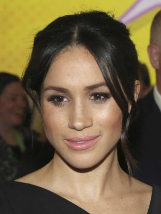 Meghan wore her hair in what is becoming her signature look, an understated elegant low bun. Picture: Chris Jackson/Pool Photo