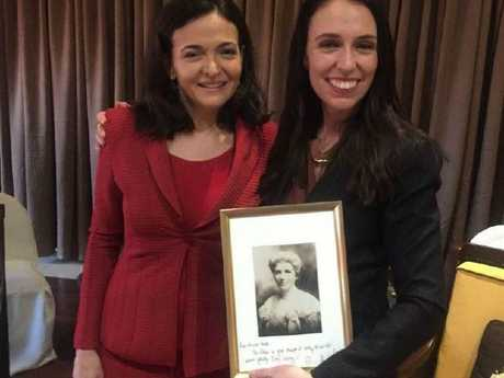 Sheryl Sandberg and Jacinda Ardern with a pic of New Zealand's first suffragette, Kate Sheppherd.  Picture:  Twitter