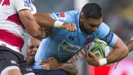Curtis Rona tries to ger the Waratahs going forward.