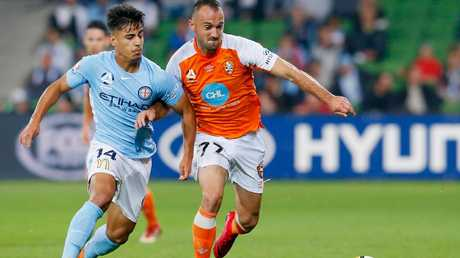 Ivan Franjic keeps Daniel Arzani at bay.