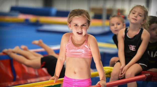The Maroochy Beach Gymnastics Club officially reopened in its orginal home on Saturday. Trying out the new facility is Evie Johnston.