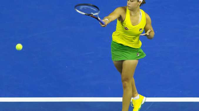 Australia's Ashleigh Barty heads for victory over the Netherlands' Quirine Lemoine in the second rubber of the Tennis Fed Cup World Group playoff in Wollongong on Saturday.