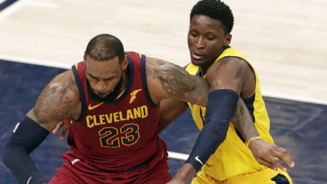 Indiana Pacers guard Victor Oladipo defends against Cleveland Cavaliers forward LeBron James.