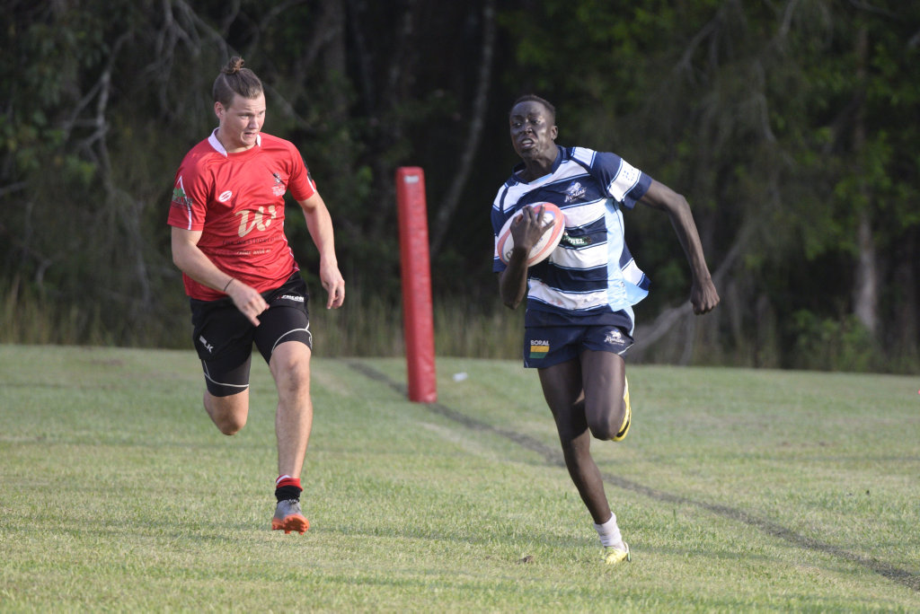 BIG RUN: SCU Marlins winger Garang Garang shows his speed down the left sideline against the Port Pirates. MNC Rugby union 21 April 2018 University Oval Photo: Brad Greenshields