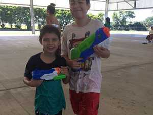 Eric Axiak and Aidan Connolly having a water fight at