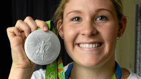 Leah Neale shows off the silver medal she won at the Rio Olympics