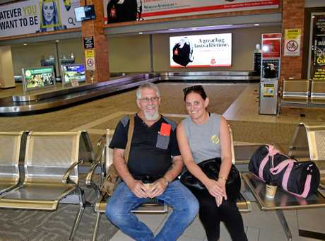 FLYING HIGH: Bouldercombe resident David Hutchinson (pictured with his daughter) said he would take advantage of direct international flights from Rockhampton Airport.
