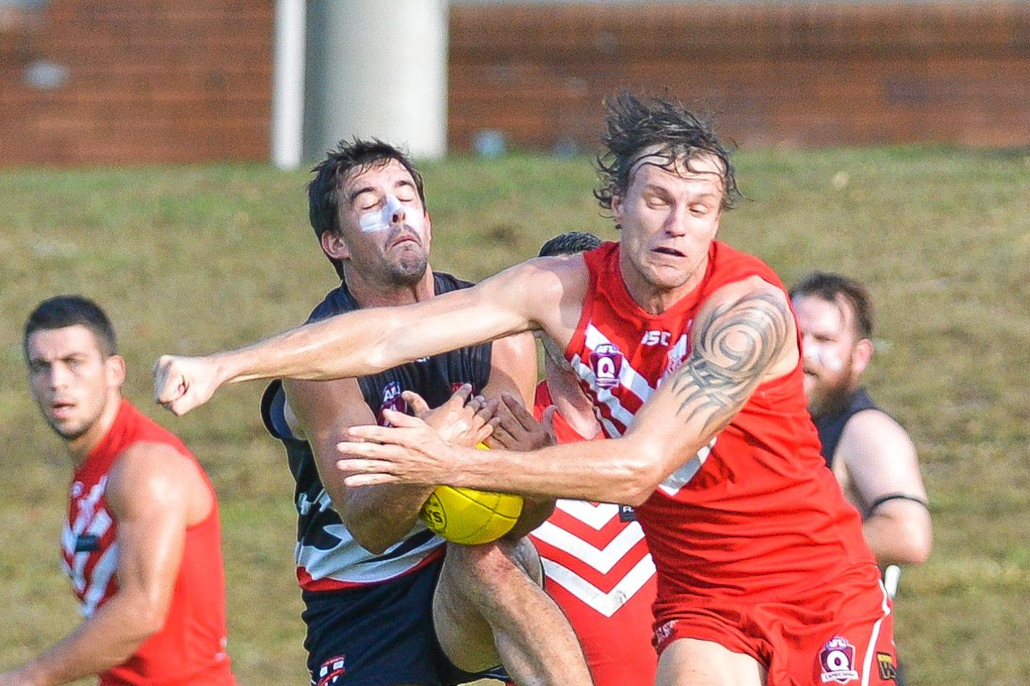 SPOILER ALERT: BITS Saints captain Stephen Pugh takes a mark against Yeppoon's Jake King in Saturday's epic.