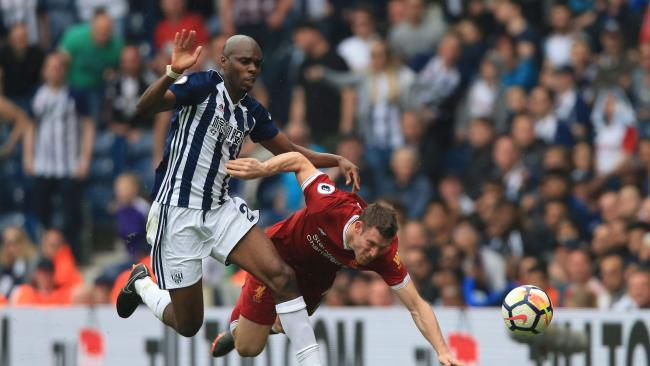 West Bromwich Albion's French-born Cameroonian defender Allan Nyom (L) battles with Liverpool's English midfielder James Milner (R)