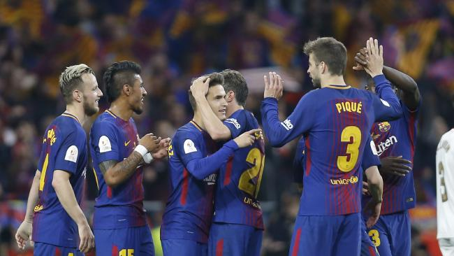 Barcelona's players celebrate after winning the Copa del Rey final soccer match