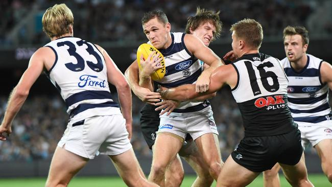 Joel Selwood (centre) was key to the Cats' win over the Power.