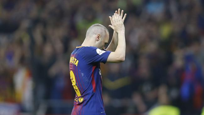 Barcelona's Andres Iniesta receives an ovation as he is substituted