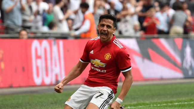 Manchester United's Chilean striker Alexis Sanchez celebrates after scoring their first goal