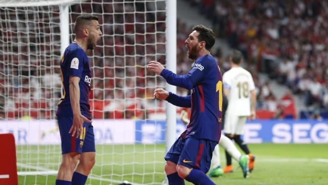 Barcelona's Lionel Messi, right, celebrates with Barcelona's Jordi Alba after scoring