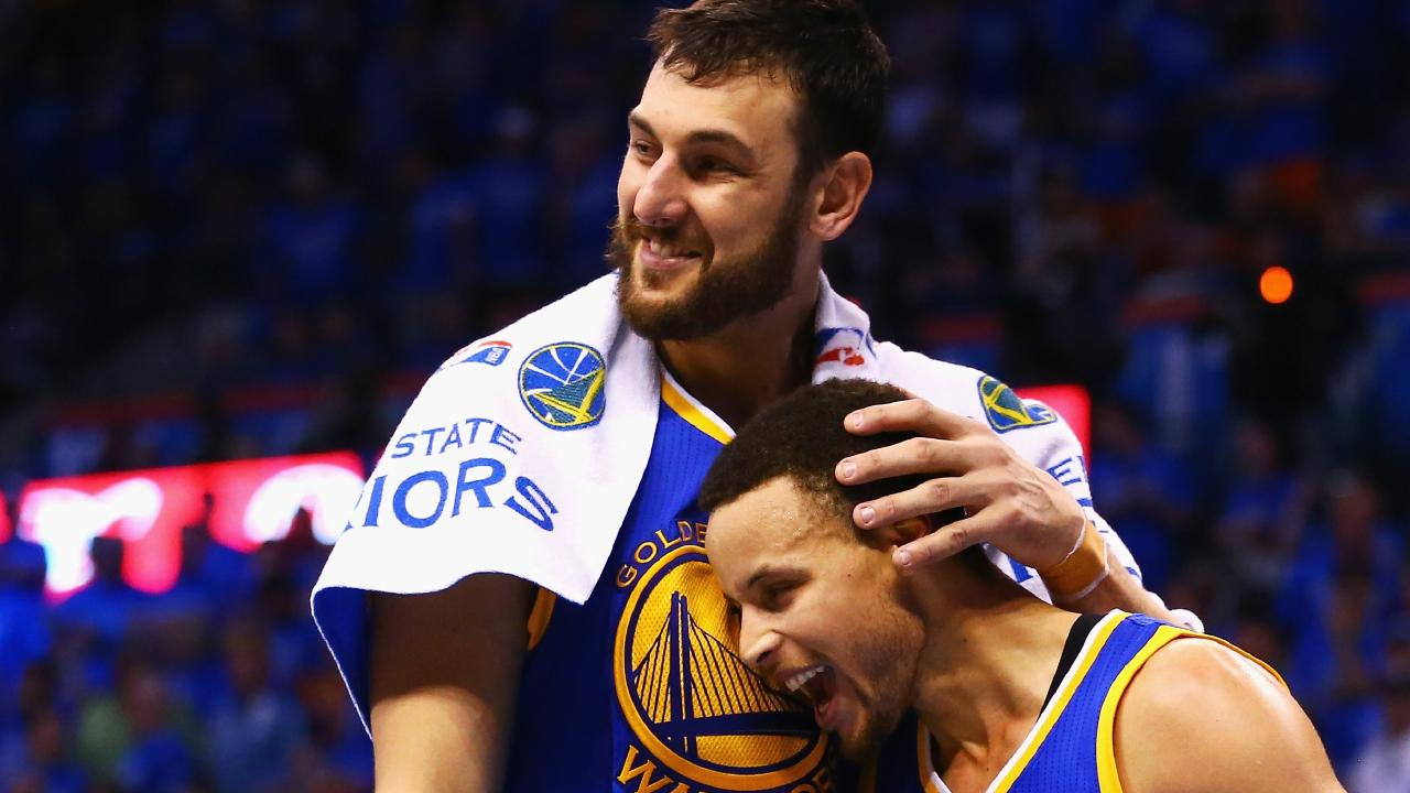 Andrew Bogut celebrates with Stephen Curry after the Warriors won the 2013 title.