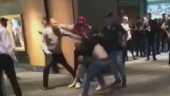 Spectators at the Adelaide Oval on Saturday night pictured fighting