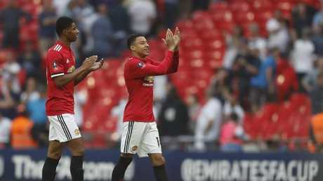 Manchester United's Marcus Rashford, left and teammate Manchester United's Jesse Lingard celebrate