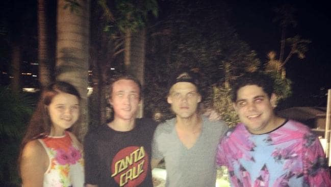 Matthew Richards backstage with Avicii (both in centre).