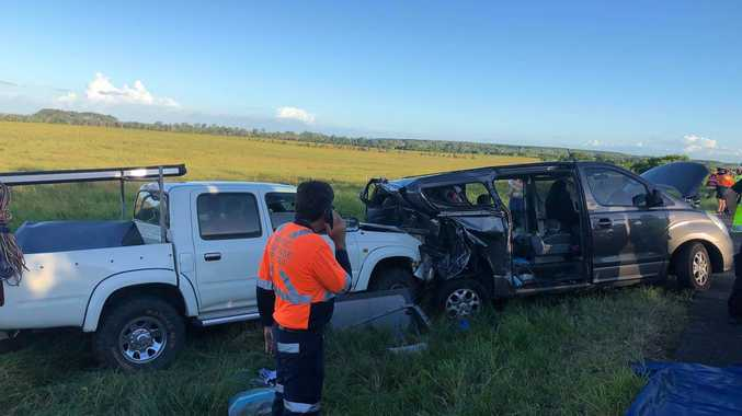 A child was trapped in the back of a family van after a two-vehicle crash on the Bruce Highway.