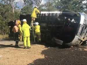 Truck rolls over on Old Toogoom Rd