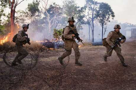 United States Marines of the Marine Rotational Force Darwin surge toward the enemy during a dawn battalion attack on the urban operations training facility at Mount Bundey Training Area during Exercise Talisman Saber 17 Field Training Exercise - North.