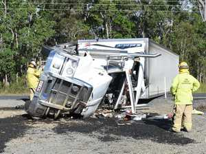 SEMI-TRAILER ROLLOVER: Driver rushed to hospital