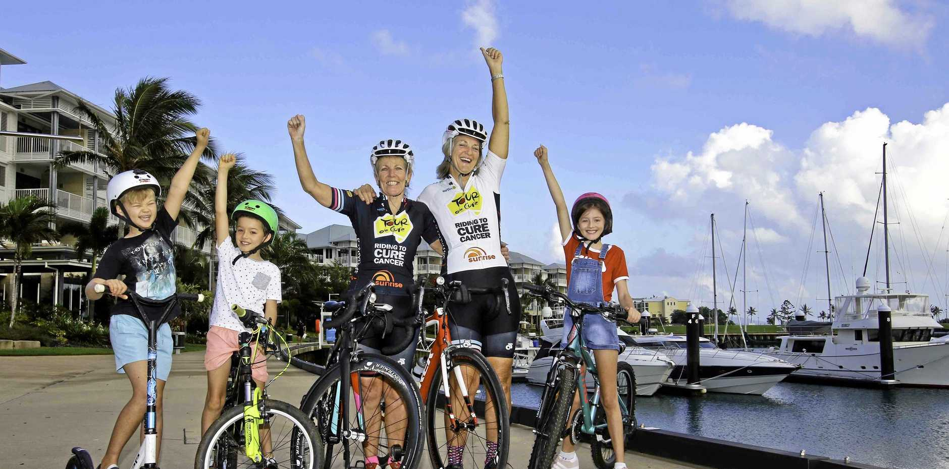 Joshua Smallwood, Ollie Ludbrook and Tayla Ludbrook with Whitsunday Tour de Cure team Shona Russell and Janelle 'Woody' Eastwood' (centre).