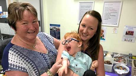 A Brassall family has appealed for help to raise $5000 to buy 2-year-old Bailey two essential items that will help him live as a 'normal' toddler. Pictured: Mum Kirsty Barten, with her mum Sharon Hall and Bailey.