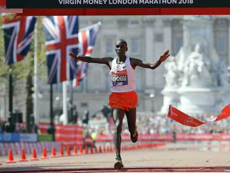 Kenya's Eliud Kipchoge reacts after crossing the finish line to win.